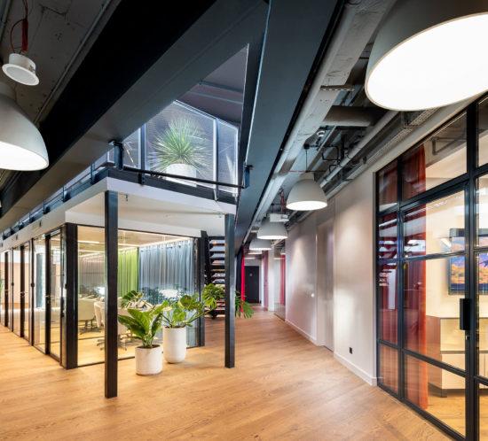 Glazed loft walls in Studio HBO Poland