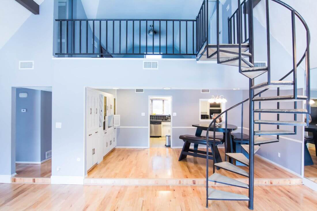 Soft Loft apartment with curved staircase and mezzanine