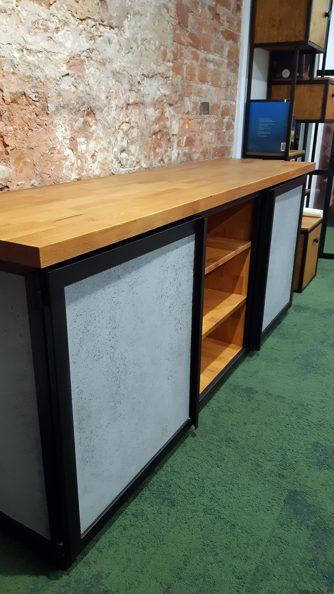 Cabinet doors in Chest of Drawers made of glass-fibre-reinforced structural concrete based on a metal frame