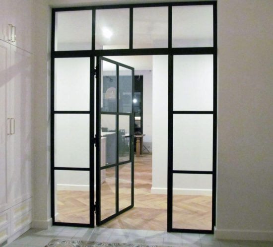 Glass Swing Loft Doors with Loft Walls separating two independent rooms painted black
