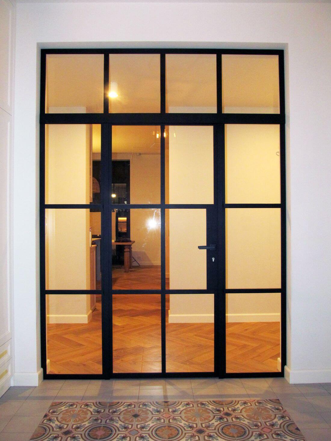 Glass Swing Loft Doors with Loft Walls illuminated by artificial light from corridor